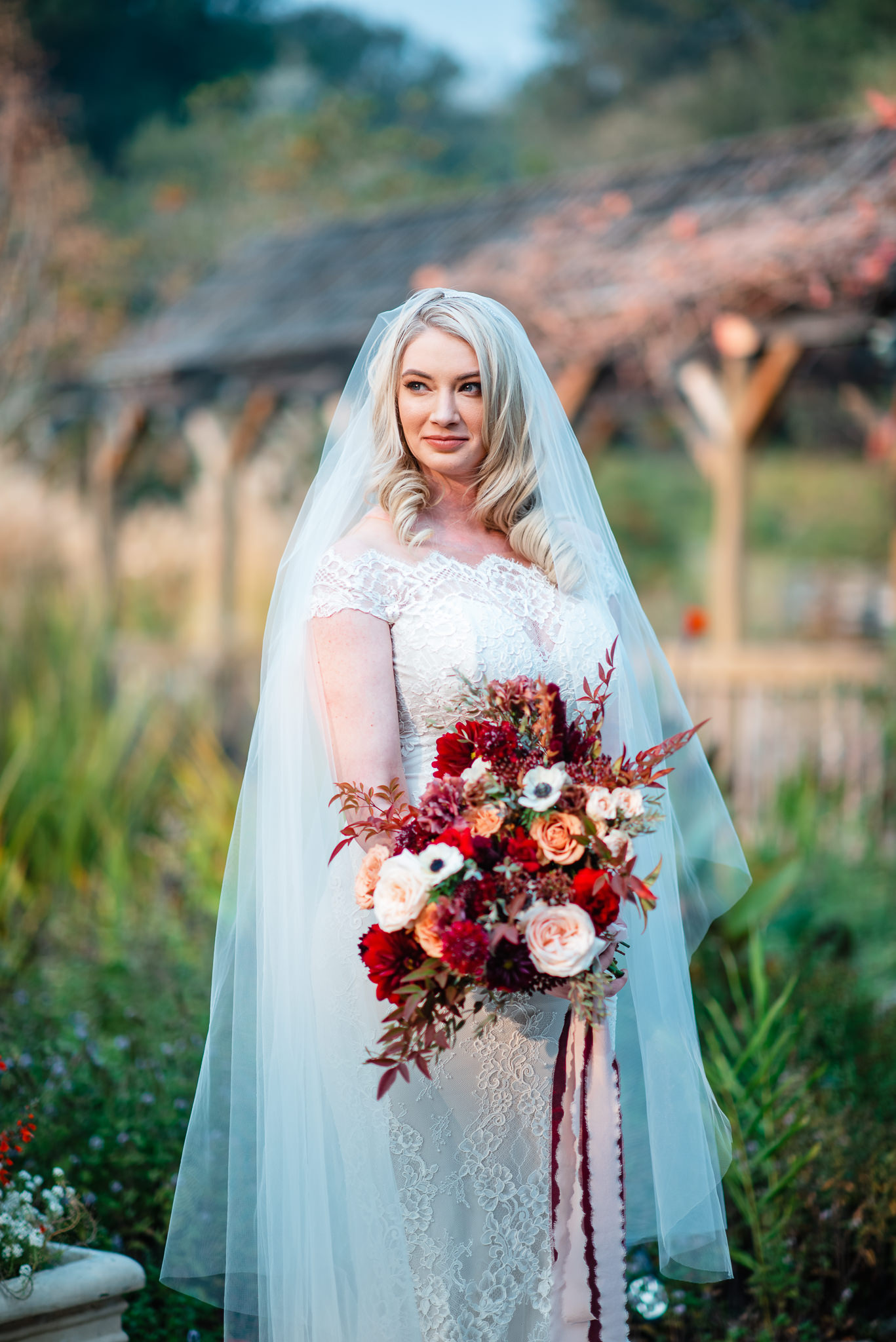 autumn bridal portrait in front of covered bridge at the Hans Fahden Vineyards in Calistoga, California